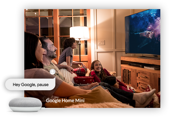 Family watching TV, with a Google Home Mini