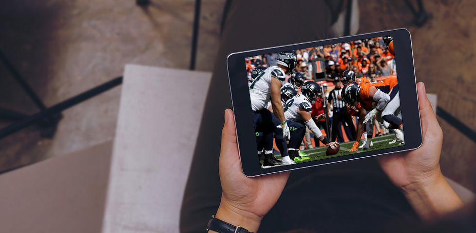watching football on a tablet